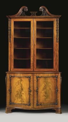 A fine George III mahogany bookcase cabinet, in the manner of Thomas Chippendale | Lot | Sotheby's