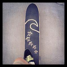 My longboard with hand cut grip tape design.