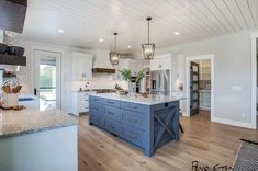 Modern farmhouse kitchen with gray blue painted kitchen island painted sm. Home, Kitchen Decor, Modern Kitchen, Eclectic Farmhouse, Island With Seating, Farmhouse Kitchen Island, Kitchen Island Design, Modern Farmhouse Kitchens, Kitchen Design
