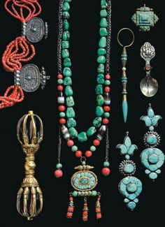 Tibet | An assortment of jewellery and ritual objects; the lot included: silver Gau boxes inlaid with turquoise; the earrings set with green and blue turquoise; ceremonial spoons in silver with stones; a turquoise pendant; 2 strands of rare tibetan turquoise beads one complete with gau box; a bracelet strung with dzi beads, coral and turquoise; two tinder pouches; a fine multi strand coral necklace with 5 silver filigree pendants