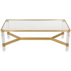 Safavieh Suzanna Coffee Table vs. Karl SpringerBrass and Lucite Coffee Table - $12,000