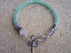 What a pretty way to finish off a viking weave bracelet!