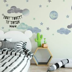 Toddler Boys Room Ideas - Interstellar Wall Decals - Gorgeous way to style a boys bedroom. #littleboysroom #boysdecor #boynursery  #nurserydecor #boynurseryideas #modernnursery