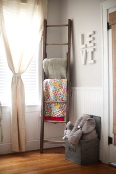 I'm going to steal this idea! Love the ladder and old toy box! As well as the wall color.