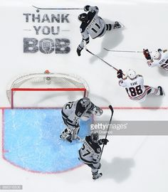 Anze Kopitar #11 of the Los Angeles Kings skates with the puck against Patrick Kane #88 and Tanner Kero #67 of the Chicago Blackhawks as Jonathan Quick #32 and Alec Martinez #27 of the Los Angeles Kings defend during the game on April 8, 2017 at Staples Center in Los Angeles, California. #LAKings #WeAreAllKings #ThankYouBob