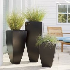 Tall, tapered planter is handcrafted in iron and finished in antiqued bronze with gold-highlighted edges. Double-walled planter has a removable planter insert with slightly higher profile. Base may be filled with sand or gravel for stability in outdoor settings. Rubber feet prevent slipping.<br /><br /><NEWTAG/><ul><li>100% iron</li><li>Antiqued bronze finish</li><li>Drainage holes with plugs provided</li><li>Nonslip feet</li><li>For indoor or outdoor use; bring indoors during freezing…