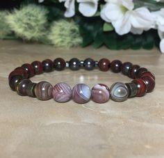 Tiger's Iron Bracelet, Botswana Agate Bracelet, Protection Against Negativity and Spells, Healing Bracelet, Selenite Crystal For Charging by SymbolicGems on Etsy https://www.etsy.com/listing/470943963/tigers-iron-bracelet-botswana-agate