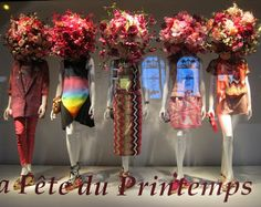 Flower heads in Printemps window.www.bridgewatercandles.com where every jar candle feeds a child for a day.