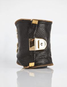 Black Leather Carry All  by CuffNGo...Great for a party because you don't have to carry a purse and you can dance hands free!