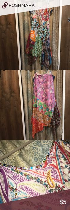 Muser multi-colored mid length assemetrical dress Muser ~ multi-colored, patterned, Imid length assemetrical dress, adjustable straps, sequins on hem at chest. No size listed fits like XS/S Muser Dresses Asymmetrical