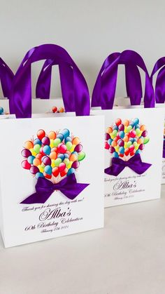 Birthday celebration gift bags with satin ribbon handles, bow, balloons and custom name. Elegant Personalized party gifts & favors for guests #partyfavors #partyideas #partygifts #favorbags #favorideas #favors #birthdayparty #giftbags #personalizedgift #purpledecor #birthdaycelebration #birthdayballons #birthdayfavors #elegantpartydecor