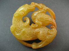 Currently at the #Catawiki auctions: A jade amulet or figurine of a dragon and phoenix  - China - Late 20 century