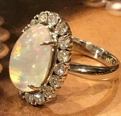 Opal and Diamond ring in Platinum