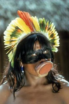 Brazil | Portrait of a Kaiapo Indian with lip plug and feather headdress. Amazon rainforest, Galera Caves area. | © Jesco von Puttkamer/Hard Rain Picture Library