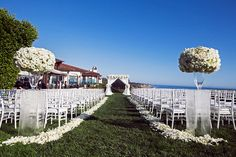 An elegant outdoor wedding in California showcases an all white color palette and the beautiful summer feel of theBacara Resort and Spa with Duke Photography.