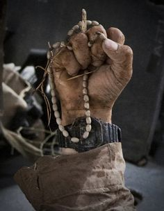 Wounded Marine Clutching his Rosary