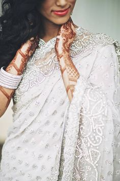 like the concept of the sari but don't like the detail as much - something not so starkly scalloped and white and silver - with more of a vintage ivory flair is more my taste.