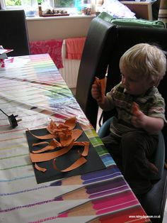 simple project to go with  The Tiger who came for tea.... cut orange strips and glue on black.