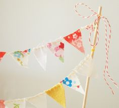 "Bunting using baker's twine as ""strand"" - would be beautiful as a cake/cupcake topper"