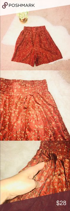 Vintage High Rise Silk Shorts with a leopard print Burnt orange/ red with a leopard print. High waisted with a banded waist. Size small. Pockets. EUC! Vintage Shorts
