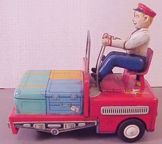 "Vintage 1950's TM Modern Toys Airport Mechanical Baggage Handler & Cart. Original vintage 1950's tin lithoed toy. Marked TM in diamond, with Trade Mark, Modern Toys under the seat. Battery operated, takes two ""D"" batteries. Nice size, 7-1/2"" long. 7"" tall and 4"" wide. The driver has mechanical action with his arms, and the front has a 180° friction type wheel, maybe a bump and go action? [click for details]"