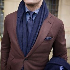 Shop this look on Lookastic:  http://lookastic.com/men/looks/dress-shirt-tie-scarf-pocket-square-blazer/7928  — Blue Chambray Dress Shirt  — Navy Tie  — Navy Scarf  — Navy Pocket Square  — Brown Wool Blazer