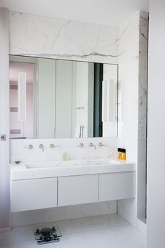 Rue Le Notre - Chic Paris apartment features white marble clad walls framing long medicine cabinet over wall-mounted his and her faucets paired with floating washstand accented with white marble trough sink. Bathroom Layout, Bathroom Kids, Master Bathroom, Bathroom Renos, Bad Inspiration, Bathroom Inspiration, Modern White Bathroom, Transitional Bathroom, Minimalist Bathroom