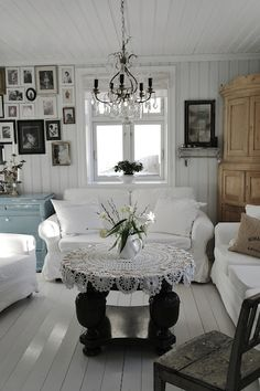 White couch, gallery wall