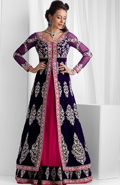 Pure velvet long jacket with net ghagra embellished with stones and zardozi work