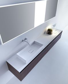 Purity has a new shape. PURE ELEMENTS composition consisting of two side drawer units and one central drawer unit with grooved handle in TH Oak finish and integrated bevelled top in Cristalplant with on-top washbasin in Ceramilux SSL. Follow Falper on it.pinterest.com/falperdesign