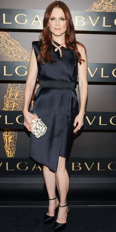 Moore set off her asymmetric design with dramatic Bulgari accessories at the label's Serpenti celebration