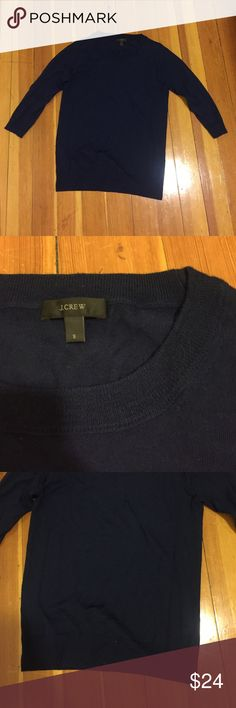 Navy blue JCrew crewneck sweater In amazing condition - 100% merino wool and super soft and warm. Cute three quarter length sleeve and crewneck style. Purchased from JCrew in the fall. J. Crew Sweaters Crew & Scoop Necks