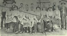 """genealogy - every family has an outlaw somewhere in the bunch and this is one of mine!  (ca 1880, Nashville, TN, cedar barrel factory where some of the men in the Jesse James Gang worked at times.  Jesse is 5th from left in front row, 3rd from left in back row is my cousin Andrew Moreman """"Mome"""" Diggs, fellow gang member along with other gang members in this picture)"""