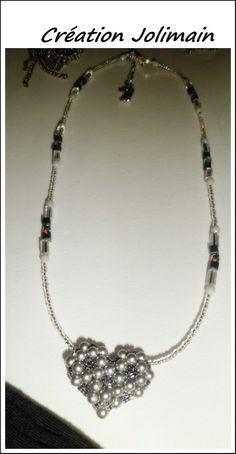 Cœur Tissé en perle de Swaroski Gris perlé...sur wire argent sertie de perles assorties qui s'agence au coeur Prix $40.00 payable par Paypal...envoyé un email à jolimain@ videotron.ca