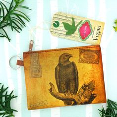 Eagle vintage print vegan coin purse from Viaggio collection by LAVISHY for wholesale to gift shops, clothing & fashion accessories boutiques, book stores in Canada, USA & worldwide. Online shopping at www.lavishy.ca Small Coin Purse, Vegan Fashion, Vintage Fashion, Vintage Style, Travel Gifts, Embroidered Flowers, Green And Purple, Vintage Prints, Unique Gifts