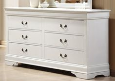 Bring home the casual elegance of the Louis Philippe collection. Case pieces include metal on metal glides, felt lined top drawers, and English dovetailing for durability and function. Features include antique brass metal handles and dark antiqued bail handles that accent the white finish. This group is made from select hardwood and veneers.