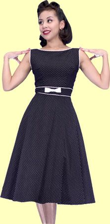 This classic 50's style dress will flatter any shape. This black dress has white micro polka dots and trim. It also features boat neck neckline, fitted bodice accentuated with white bow, swing skirt and back zip! Adorable!