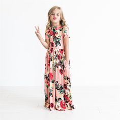 ​This Kids Floral Maxi Dress is so adorable, your child will want one in every color! They are so comfortable and made from the softest fabric!