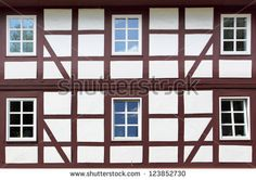 Wall of old timber framing house - stock photo