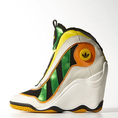 Jeremy Scott gives the slam-dunk Crazy 97 shoe a fresh makeover in his signature eclectic style, with a feminine wedge, premium full-grain leather upper and shiny textile inserts. Sneaker Heels, Wedge Sneakers, Wedge Boots, Shoe Boots, High Top Sneakers, Fashion Boots, Sneakers Fashion, Jeremy Scott Adidas, Funny Shoes