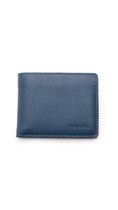 LOVE the shade of blue in this simple wallet // gifts for him