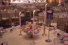 A lush Floral piece surrounded by taper candles Small Centerpieces, Wedding Consultant, Set Up An Appointment, Taper Candles, Event Design, Lush, Table Decorations, Floral, Home Decor