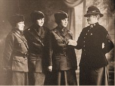 "Here is a well known photo of Gunnery Sergeant Opha Mae Johnson, inspecting 3 Marines (F), taken in 1918, wearing her (possibly) one of a kind women's dress blue uniform. The three Marines (F) she is inspecting are wearing their standard uniform. While a Marine (F) dress blue uniform never may have been authorized by regulations, it clearly was, at least in one instance ""allowed."""