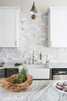 Gorgeous two-tone kitchen design with white upper cabinets gray lower cabinets carrara marble counters and marble subway tile backsplash a farm sink and a beautiful wood island and brass hardware. Gorgeous two-tone ki Beautiful Kitchen Designs, Beautiful Kitchens, Vintage Modern, Home Design, Design Ideas, White Kitchen Backsplash, Backsplash Ideas, Tile Ideas, Kitchen White