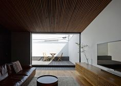 Wave is a surfer's house with a protruding windowless facade and a secret courtyard.
