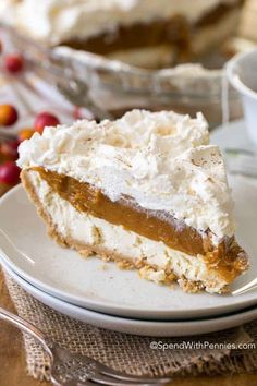 ***No Bake Pumpkin Cheesecake ~ is a dreamy dessert with layers of cheesecake, pumpkin and whipped topping all nestled in a graham crust. It is so creamy and delicious, it will become your new fall dessert go to!