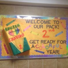 """Welcome bulletin board that was used for first-year move in at McDaniel College. How to make the board 3D: Take an empty diaper box, and tape it to the board making sure it is secure. Cover the box in paper. Crayons were made out of construction paper. """"Rouzer"""" is the building that the first-year students lived in and """"2nd"""" is the floor they live on."""