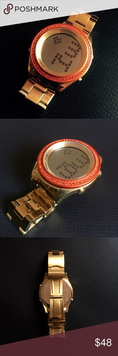 Betsey Johnson Gold Wristwatch Beautiful statement piece! A watch with red jewels encrusted circling the circumference of the timepiece, on a gold colored chain. Some minor wear in great shape. Fully functioning and lights up with a press of a button. Water Resistant  Stainless Steel Caseback Swarovski elements Betsey Johnson Accessories Watches