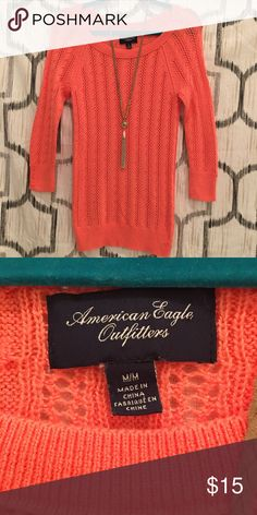 American Eagle coral long sweater size Medium Beautiful soft coral sweater by American Eagle. 3/4 length sleeves with button detail on bottom. In EUC. American Eagle Outfitters Sweaters Crew & Scoop Necks
