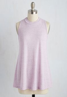 Dressed in this swingy, ModCloth-exclusive top, you steep a potpourri of tea and enjoy an early morning meditation. The heather purple hue of this mock-neck tank sets a fittingly soothing tone, while its light, ribbed construction allows you the comfort of enjoying your brew in style.
